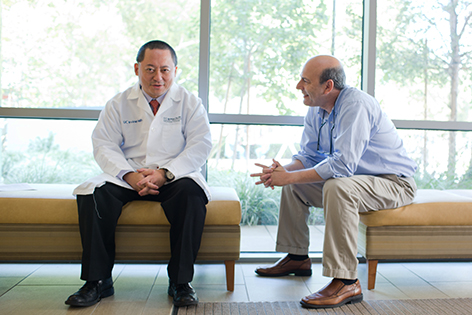 Dr. Sai-Hong Ignatius Ou and his patient, Allen Fremont, whose